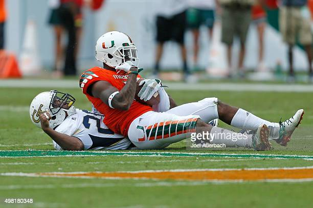 Stacy Coley of the Miami Hurricanes catches the ball over Lawrence Austin of the Georgia Tech Yellow Jackets on November 21 2015 at Sun Life Stadium...
