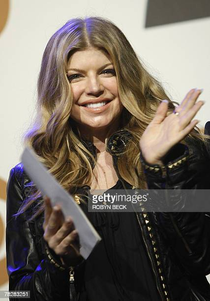 Stacy Ferguson aka Fergie reacts to learning she is nominated in the Best Female Pop Vocal Performance category during the nominations announcement...