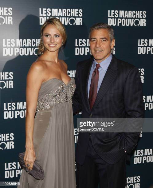 Stacy Keibler and George Clooney attend 'The Ides of March' Paris Premiere at Cinema UGC Normandie on October 18 2011 in Paris France