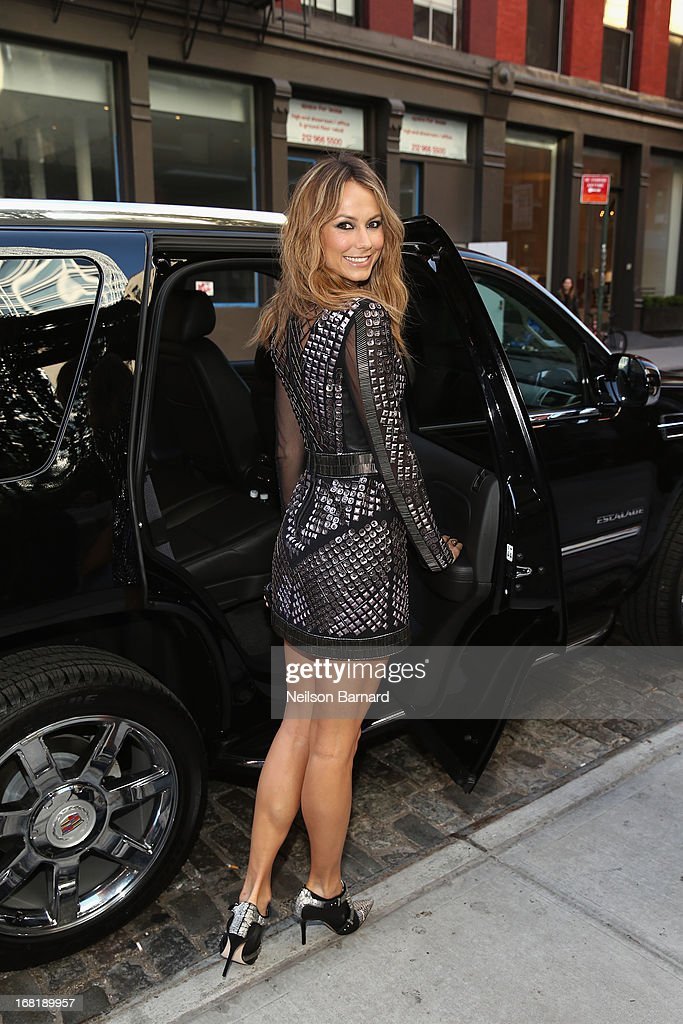 Stacy Keibler poses in a Rachel Roy design, headed to The Costume Institute Gala in a Cadillac Escalade on May 6, 2013 in New York City.