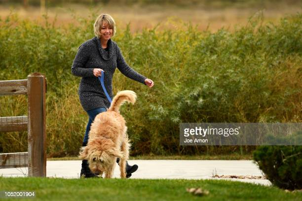 Stacy Lambright plays with her goldendoodle Teddy near the South Fork Preble Creek Trail by her home in North Creek Farms The trail is close by the...