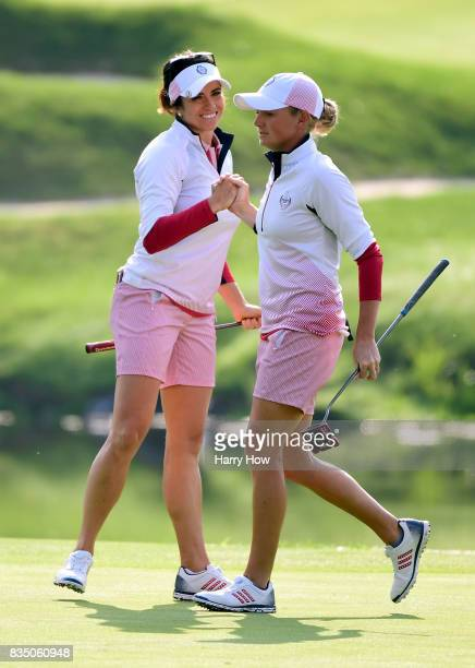 Stacy Lewis and Gerina Piller of the United States celebrate a win of hole three over Team Europe during the morning foursomes matches of the Solheim...