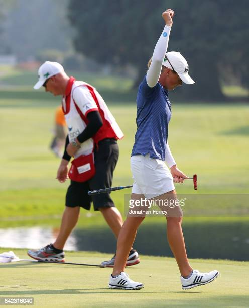 Stacy Lewis celebrates on the 18th green after her victory during the final round of the LPGA Cambia Portland Classic at Columbia Edgewater Country...