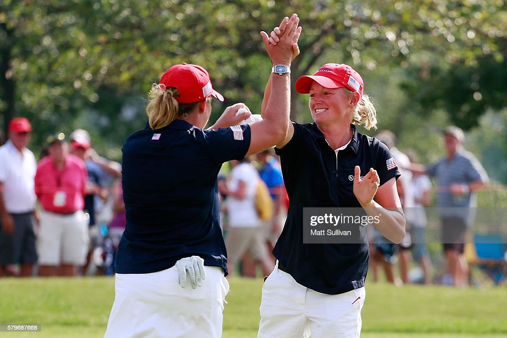 Stacy Lewis celebrates with (L) Cristie Kerr of the United States after Kerr won her match during the singles matches of the 2016 UL International Crown at the Merit Club on July 24, 2016 in Chicago, Illinois.