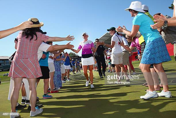 Stacy Lewis celebrates with fans on the 18th green after winning the North Texas LPGA Shootout Presented by JTBC at the Las Colinas Country Club on...