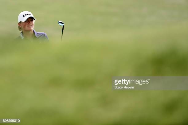 Stacy Lewis chips to the 17th green during the second round of the Meijer LPGA Classic at Blythefield Country Club on June 16 2017 in Grand Rapids...