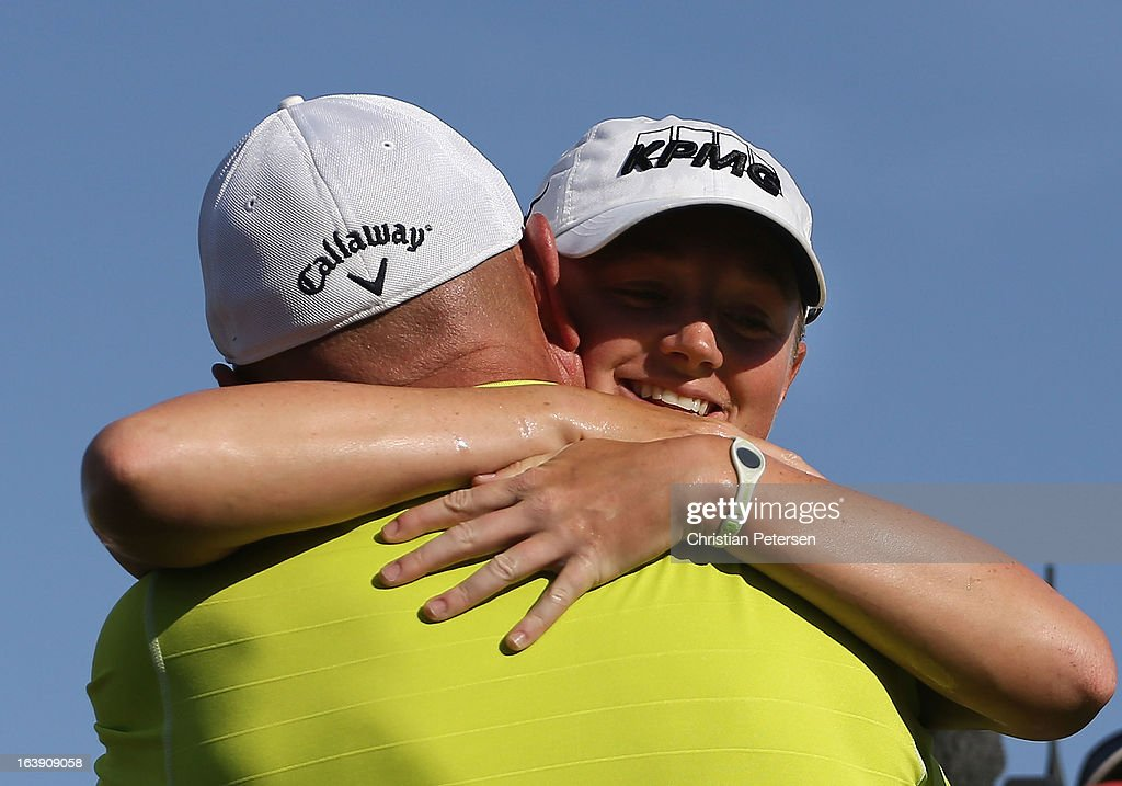 Stacy Lewis hugs her father Dale Lewis after winning the the RR Donnelley LPGA Founders Cup at Wildfire Golf Club on March 17, 2013 in Phoenix, Arizona.