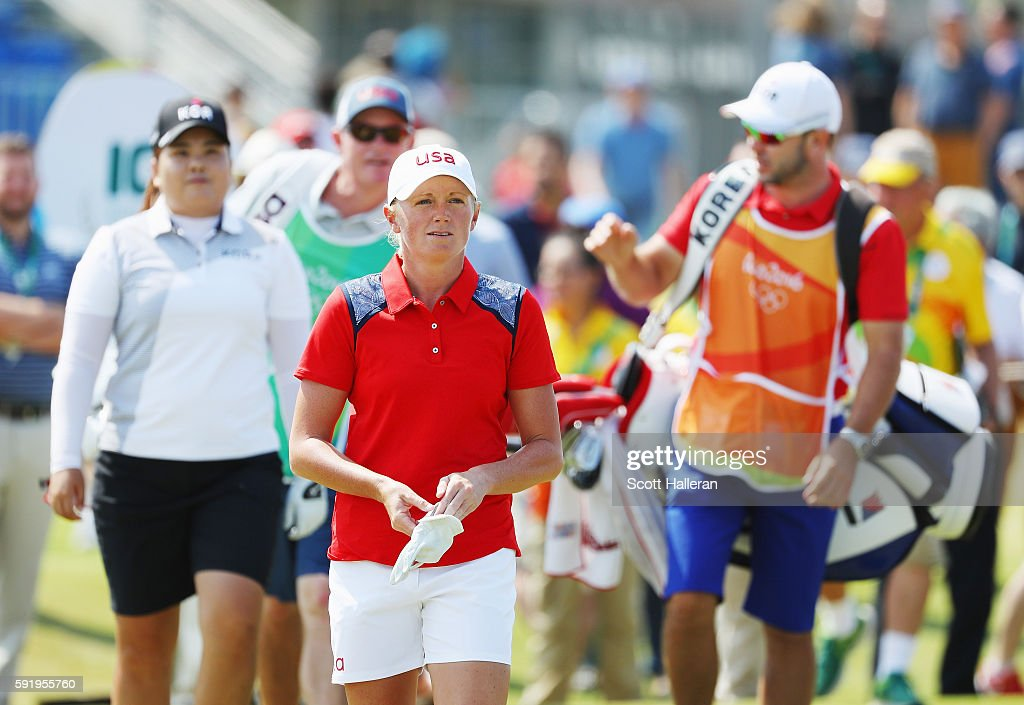 Stacy Lewis of the United States (R) and Inbee Park of Korea walk off the first tee during the third round of the Women's Individual Stroke Play golf on Day 14 of the Rio 2016 Olympic Games at Olympic Golf Course on August 19, 2016 in Rio de Janeiro, Brazil.