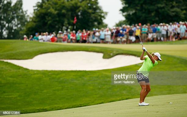 Stacy Lewis of the United States hits her approach shot on the second hole during the final round of the US Women's Open at Lancaster Country Club on...