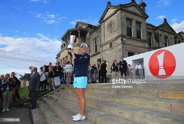 Stacy Lewis of the United States lifts the trophy following her victory during the final round of the Ricoh Women's British Open at the Old Course St...