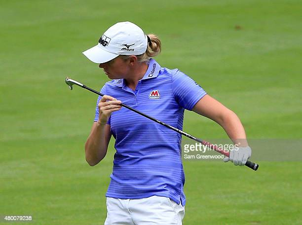 Stacy Lewis of the United States looks at her club on the fourth hole during the first round of the US Women's Open at Lancaster Country Club on July...