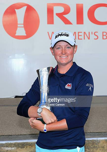 Stacy Lewis of the United States poses with the trophy following her victory during the final round of the Ricoh Women's British Open at the Old...