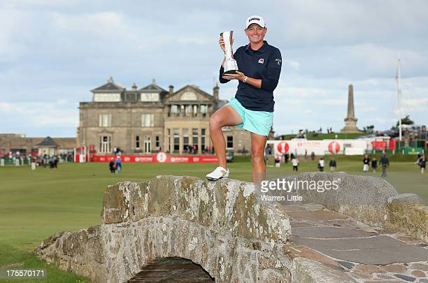 Stacy Lewis of the United States poses with the trophy on the Swilcan Bridge following her victory during the final round of the Ricoh Women's...
