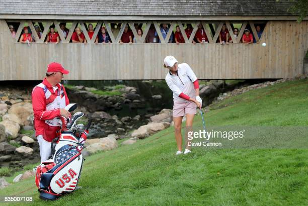 Stacy Lewis of the United States Team Team plays her second shot in her match with Gerina Piller against Karine Icher and Catriona Matthew of the...