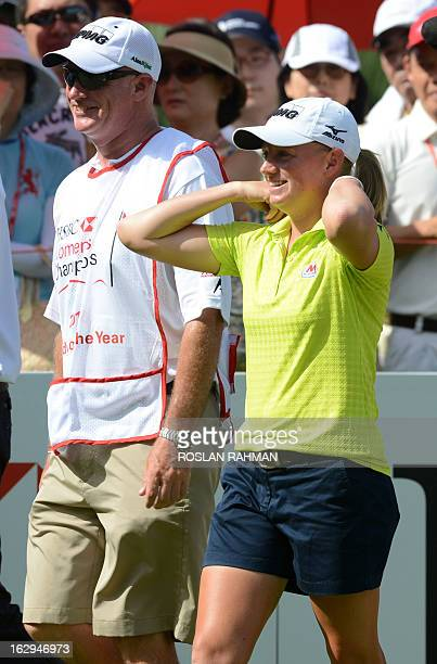 Stacy Lewis of the US walks with Travis Wilson her best caddy of the year 2013 during round three of the HSBC Women's Champions LPGA golf tournament...