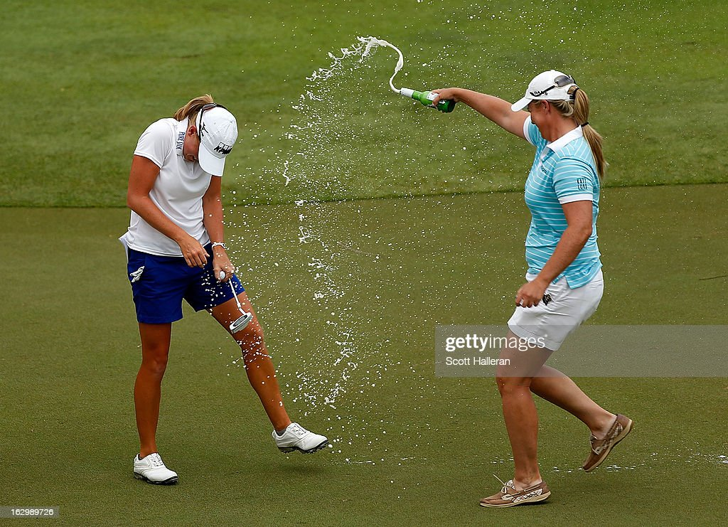 Stacy Lewis of the USA (L) is sprayed with beer by Brittany Lincicome after Lewis won the HSBC Women's Champions at the Sentosa Golf Club on March 3, 2013 in Singapore, Singapore.