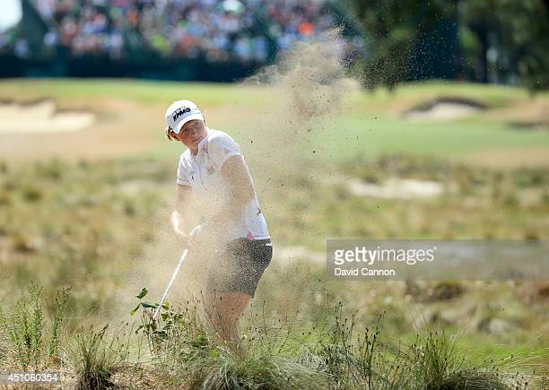 Stacy Lewis of the USA plays her second shot at the par 4 14th hole where she made bogey during the final round of the 69th US Women's Open at...