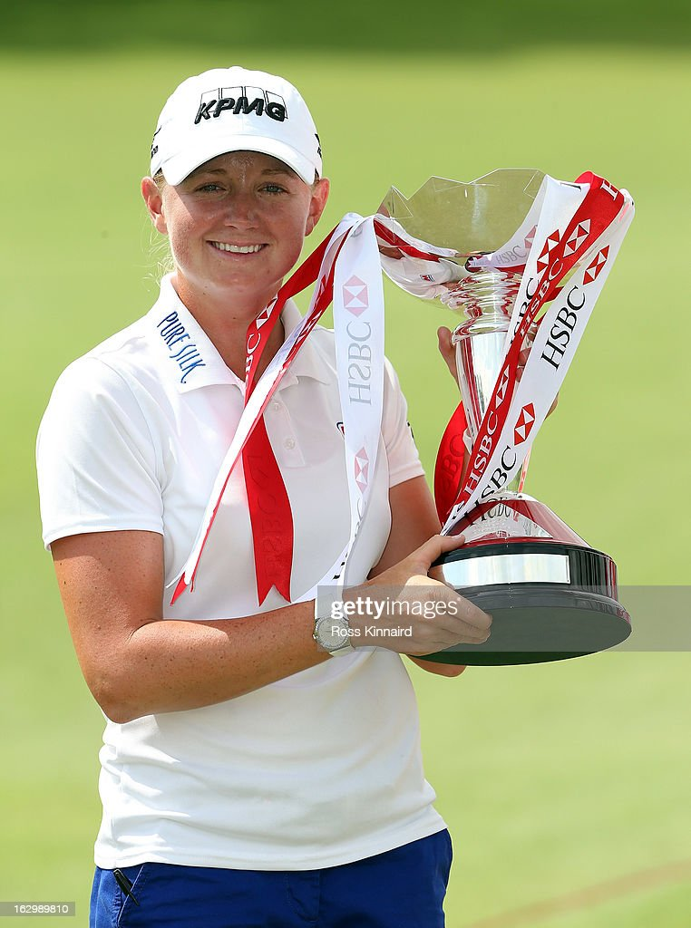 Stacy Lewis of the USA with the winners trophy after the final round of the HSBC Women's Champions at the Sentosa Golf Club on March 3, 2013 in Singapore, Singapore.