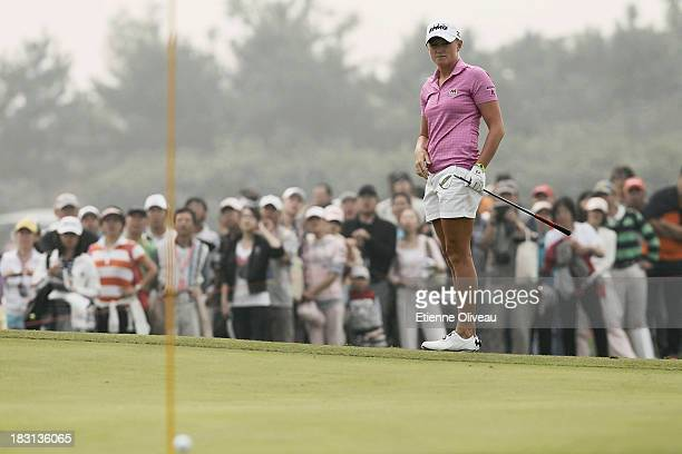 Stacy Lewis of United States reacts to a putt during the third round of the Reignwood LPGA Classic at Pine Valley Golf Club on October 5 2013 in...