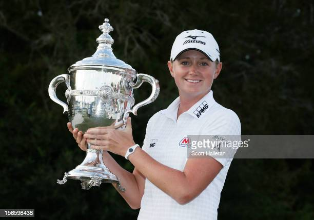 Stacy Lewis poses with the 2012 Rolex Player of the Year trophy after the third round of the CME Group Titleholders at the TwinEagles Club on...