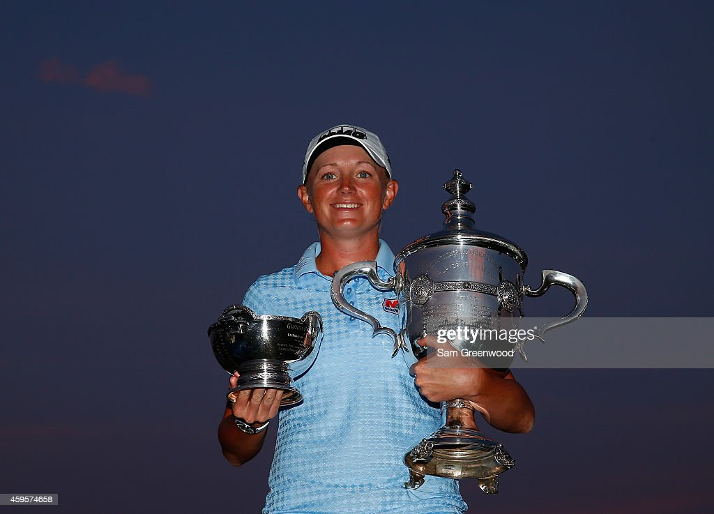 Stacy Lewis poses with the Player of the Year trophy and the Vare trophy following the final round of the CME Group Tour Championship at Tiburon Golf Club on November 23, 2014 in Naples, Florida.