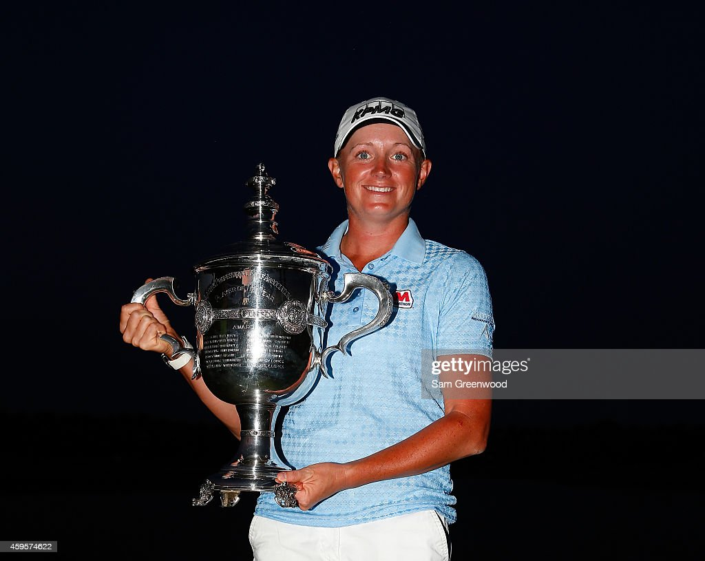 Stacy Lewis poses with the Player of the Year trophy following the final round of the CME Group Tour Championship at Tiburon Golf Club on November 23, 2014 in Naples, Florida.