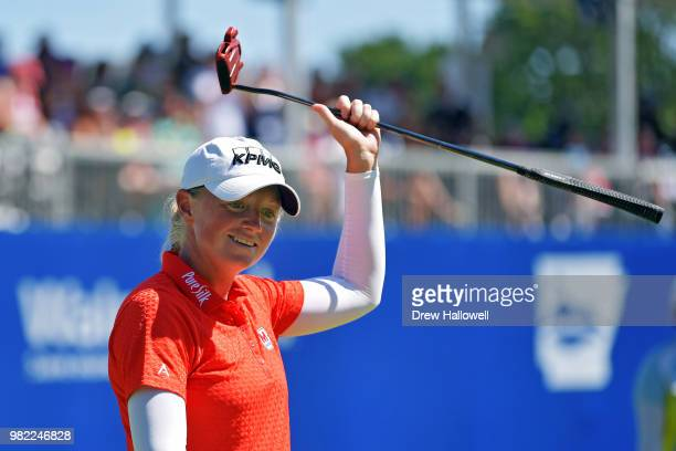 Stacy Lewis raises her club to the crowd after a birdie on the 17th hole during the second round of the Walmart NW Arkansas Championship Presented by...