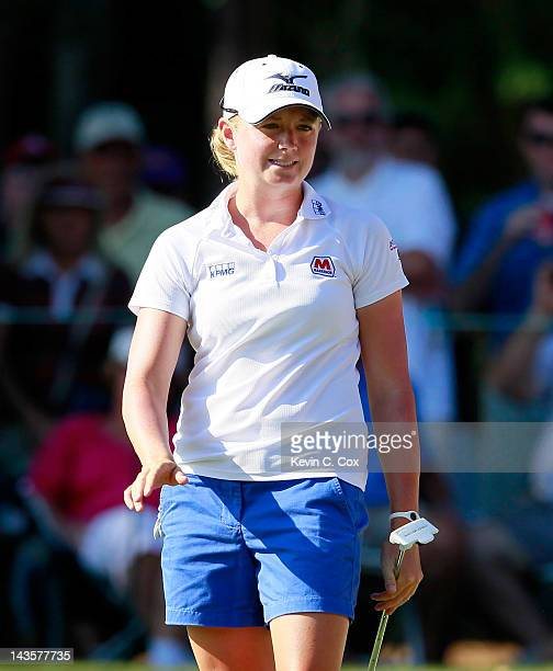 Stacy Lewis reacts after her birdie putt on the 18th green to set up a short par putt for the win during the final round of the Mobile Bay LPGA...