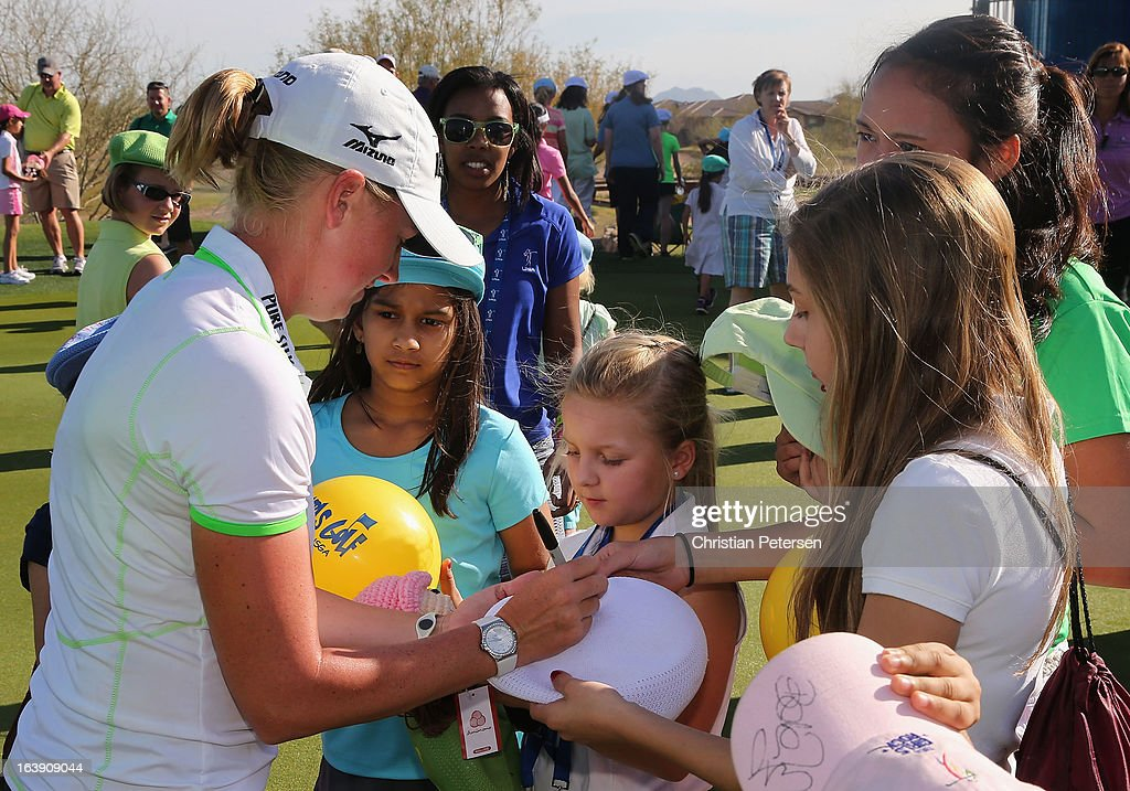 Stacy Lewis signs autographs for kids from the 'LPGA-USGA Girls Golf' after winning the the RR Donnelley LPGA Founders Cup at Wildfire Golf Club on March 17, 2013 in Phoenix, Arizona.