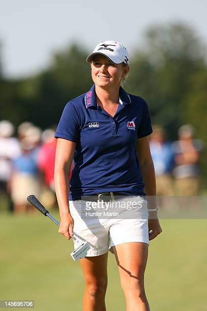 Stacy Lewis smiles as she walks to the 18th green during the final round of the ShopRite LPGA Classic on the Bay Course at Seaview Resort on June 3...