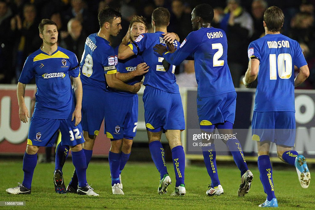 Stacy Long (3rd L) of AFC Wimbledon is congratulated by teammates after scoring the equalizing goal during the npower League Two match between AFC Wimbledon and Aldershot Town at the Cherry Red Records Stadium on November 17, 2012 in Kingston upon Thames, England.