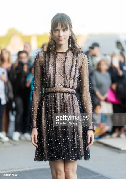 Stacy Martin wearing a sheer dress outside Miu Miu Cruise Collection during Paris Fashion Week Haute Couture Fall/Winter 20172018 Day One on July 2...