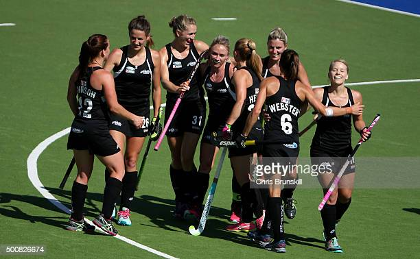 Stacy Punt of New Zealand celebrates scoring the first goal with her teammates during the quarter final match between New Zealand and Great Britain...