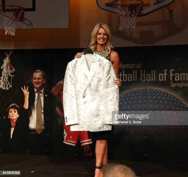 Stacy Sager accepts a sports coat on behalf of her husband Craig Sager after winning the Electronic Media Award at the BunnGowdy Awards Dinner as...