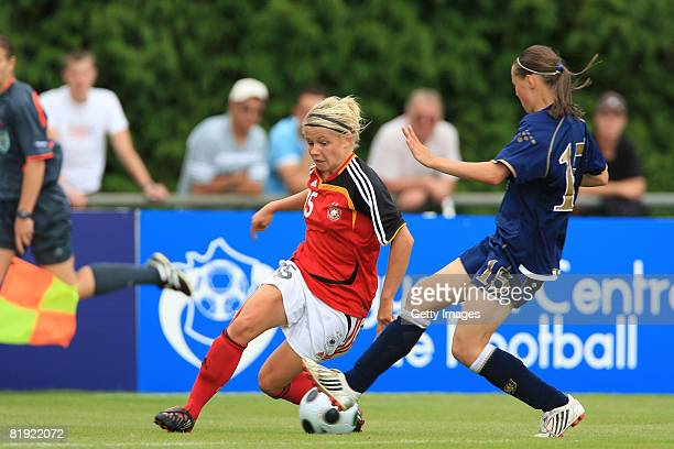 Stacy Williamson of Scotland and Julia Simic of Germany fight for the ball during the Women's U19 European Championship match between Scotland and...