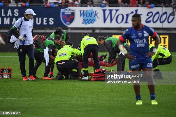 Stade Français' French hooker Laurent Panis is taken away on a stretcher after getting injured during the French Top 14 rugby union match between...
