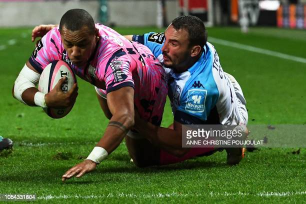 Stade Français' Paris French center Gael Fickou scores a try against Montpellier's French flanker Louis Picamoles during the French Top 14 rugby...