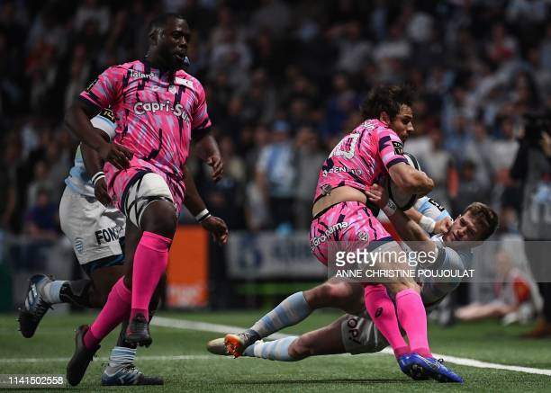 Stade Francais' Argentine flyhalf Federico Nicolas Sanchez vies with Racing92's French full back Louis Dupichot during the French Top 14 rugby union...