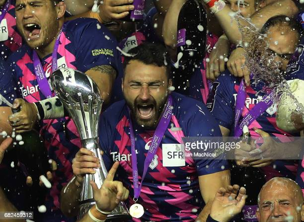 Stade Francais celebrate with the trophy following their team's 25-17 victory during the European Rugby Challenge Cup Final between Gloucester and...