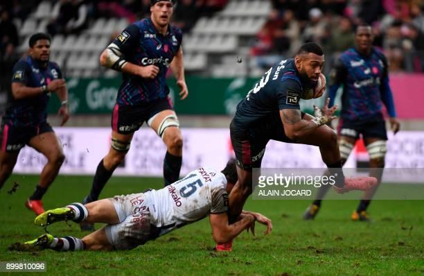 TOPSHOT Stade Francais' Fidjian winger Waisea Nayacalevu Vuidravuwalu vies with Bordeaux's Nans Ducuing during the Top 14 rugby match between Stade...