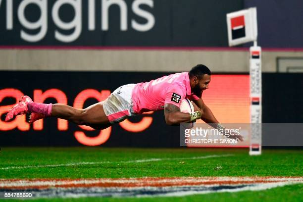 Stade Francais' Fijian centre Waisea Nayacalevu Vuidravuwalu dives and scores a try during the French Top 14 rugby union match between Stade Francais...