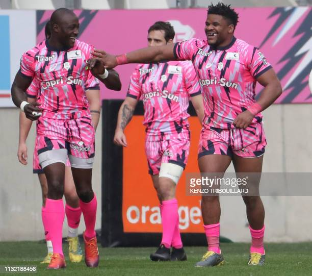 Stade Francais' French center Jonathan Danty celebrates after scoring a try during the French Top 14 rugby union match between Stade Francais and...