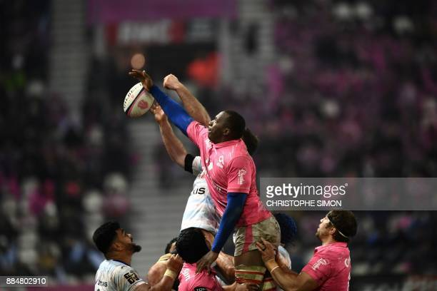 Stade Francais' French flanker Sekou Macalou jumps for the ball in a line out during the French Top 14 rugby union match between Stade Francais and...