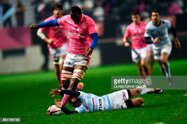 Stade Francais' French flanker Sekou Macalou vies for the ball with Racing 92's French scrumhalf Teddy Iribaren during the French Top 14 rugby union...