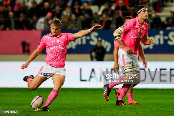 Stade Francais' French flyhalf Jules Plisson kicks a penalty during the French Top 14 rugby union match between Paris Stade Francais and Brive CAB on...