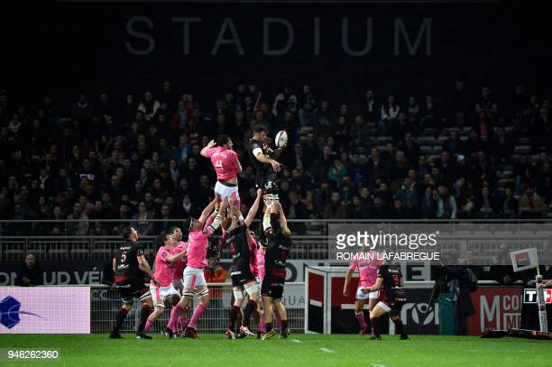 Stade Francais' French lock Paul Gabrillagues and Lyon's French flanker Julien Puricelli jump to catch the ball during the French Top 14 rugby union...