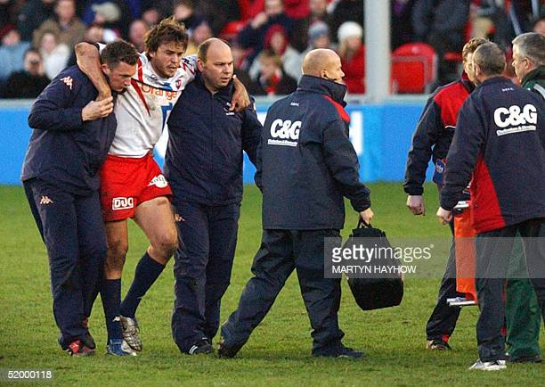 Stade Francais' Juan Martin Hemandez is helped from the field during their European cup match against Gloucester, 16 January 2005. Stade Francais...