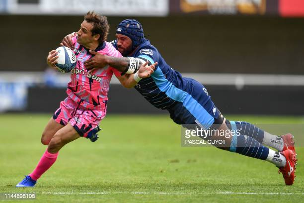 Stade Francais' Nicolas Sanchez is tackled by Montpellier's Fiji wing Nemani Nadolo during the French Top 14 rugby union match between Montpellier...