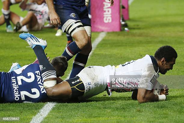 Stade Francais Paris' Fijian winger Waisea Nayacalevu Vuidravuwalu scores a try during the French Top 14 rugby union match between Stade Francais...