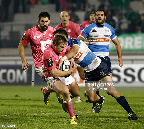 Stade Francais' player Jules Plisson is tackled by Benetton Treviso player Hayward Jayden during the European Rugby Champions Cup match between...